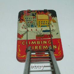Neat Vintage Tin Litho Wind Up Marx Climbing Fireman