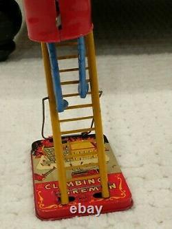 Vintage Original Marx Wind-Up Climbing Ladder Fireman Tin Toy Works